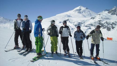 Enjoy a ski lesson at ski school and make new friends